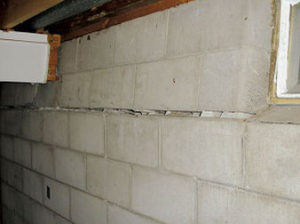 What causes tilting foundation walls