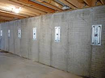 Repairing and straightening tilting foundation walls