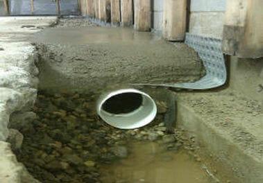Restore the floor and bury discharge line